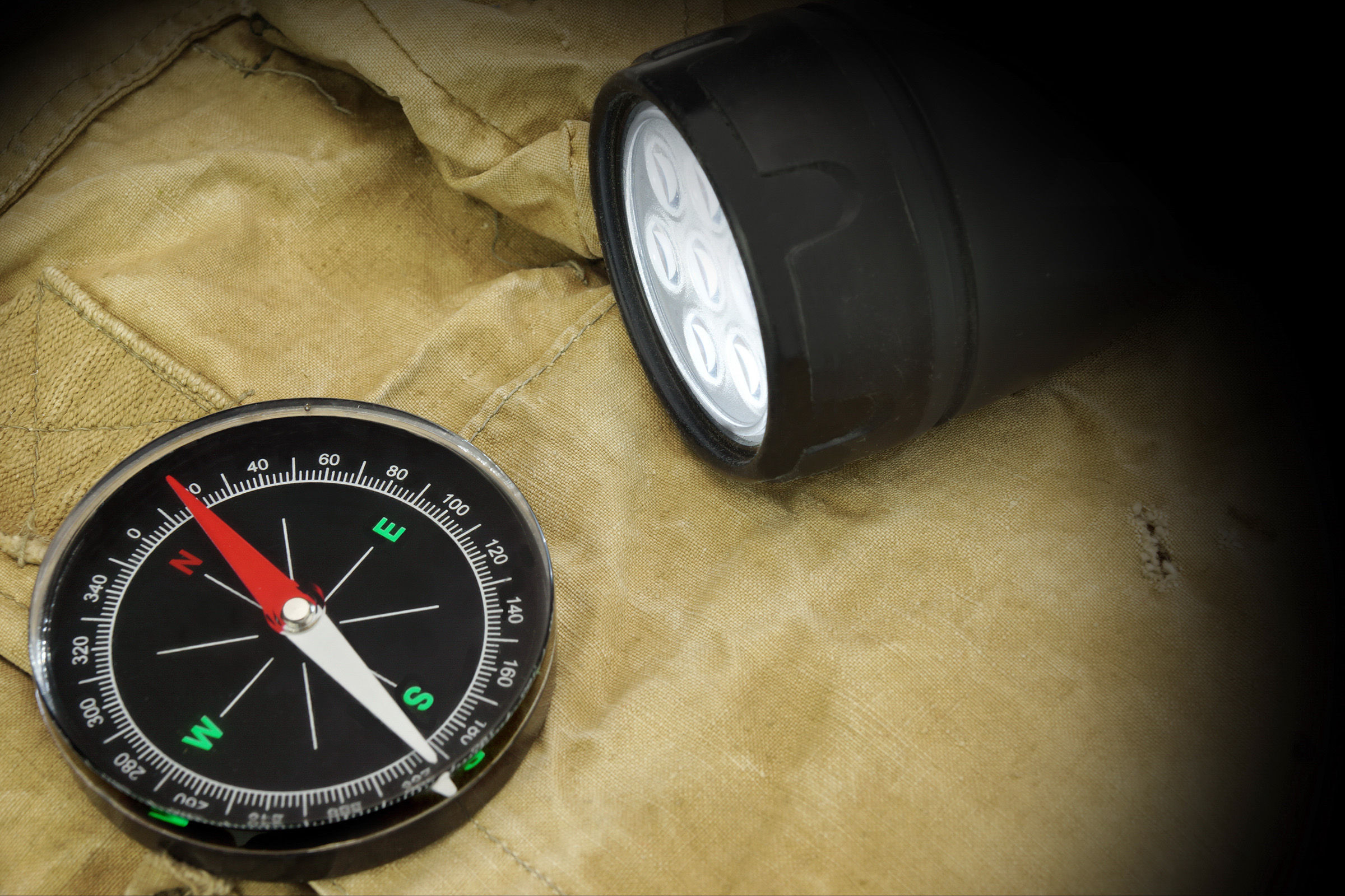 Flash light and compass